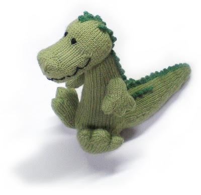 a knitted green cuddlesome crocodile called magda