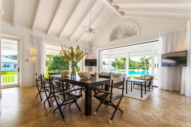 Informal dining room in Celine Dion's home with a view of the pool and backyard