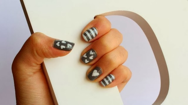 http://curlymade.blogspot.pt/2014/01/valentines-day-nails.html