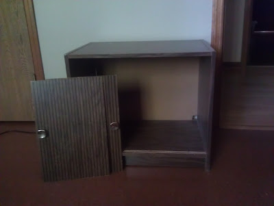 Ancient and ugly, but still useful particle board cabinet