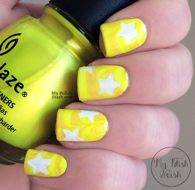 yellow watermarble nail art