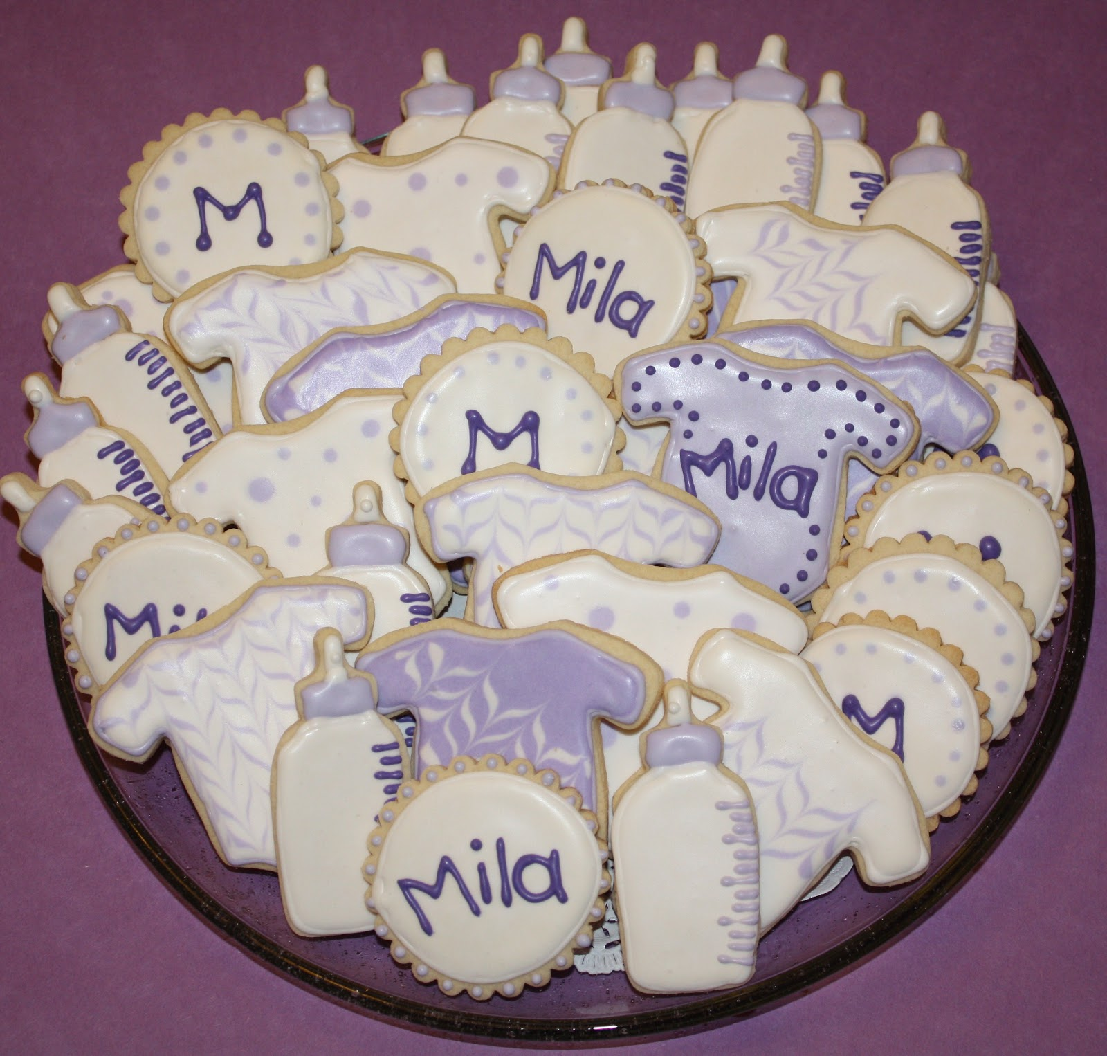mel 39 s sweet treats baby cookies for a purple and white baby shower