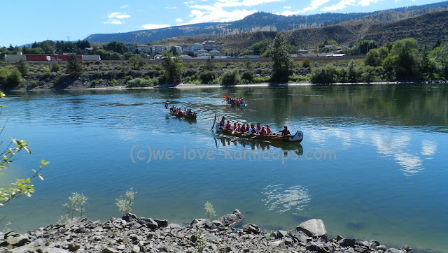 3 canoes paddling down the river