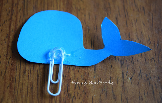 How to attach the paper clip to the whale bookmark