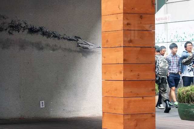 Currently touring around East Asia, Spanish artist Pejac recently stopped in Seoul and left couple of recognizable pieces. Working in an environment that is not common on the street art maps, the artist used this opportunity well to create couple of striking signature illusions.