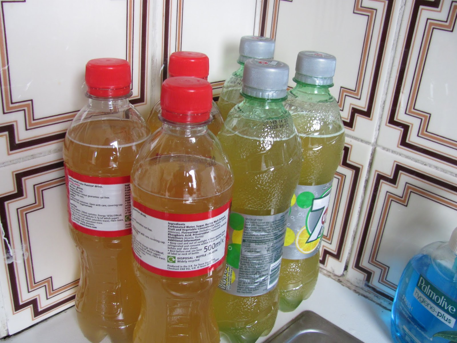 Home made hard apple cider in cola and 7UP bottles in Dublin, Ireland