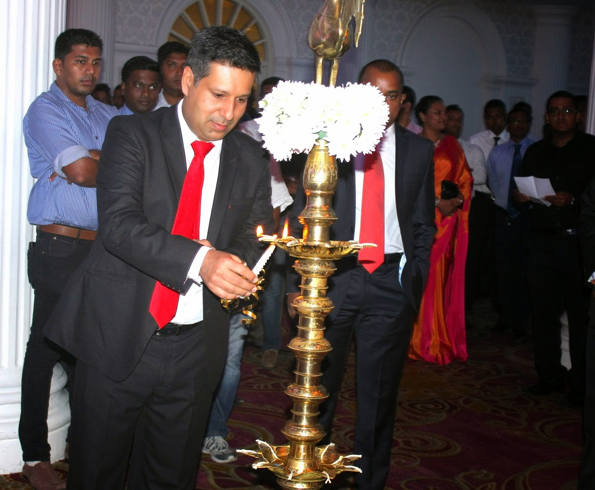 R&M Managing Director Gaurav Ahluwalia lights the oil lamp at the R&M launch in Sri Lanka