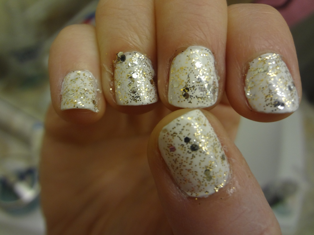 White Nail Polish With Gold Glitter- HireAbility