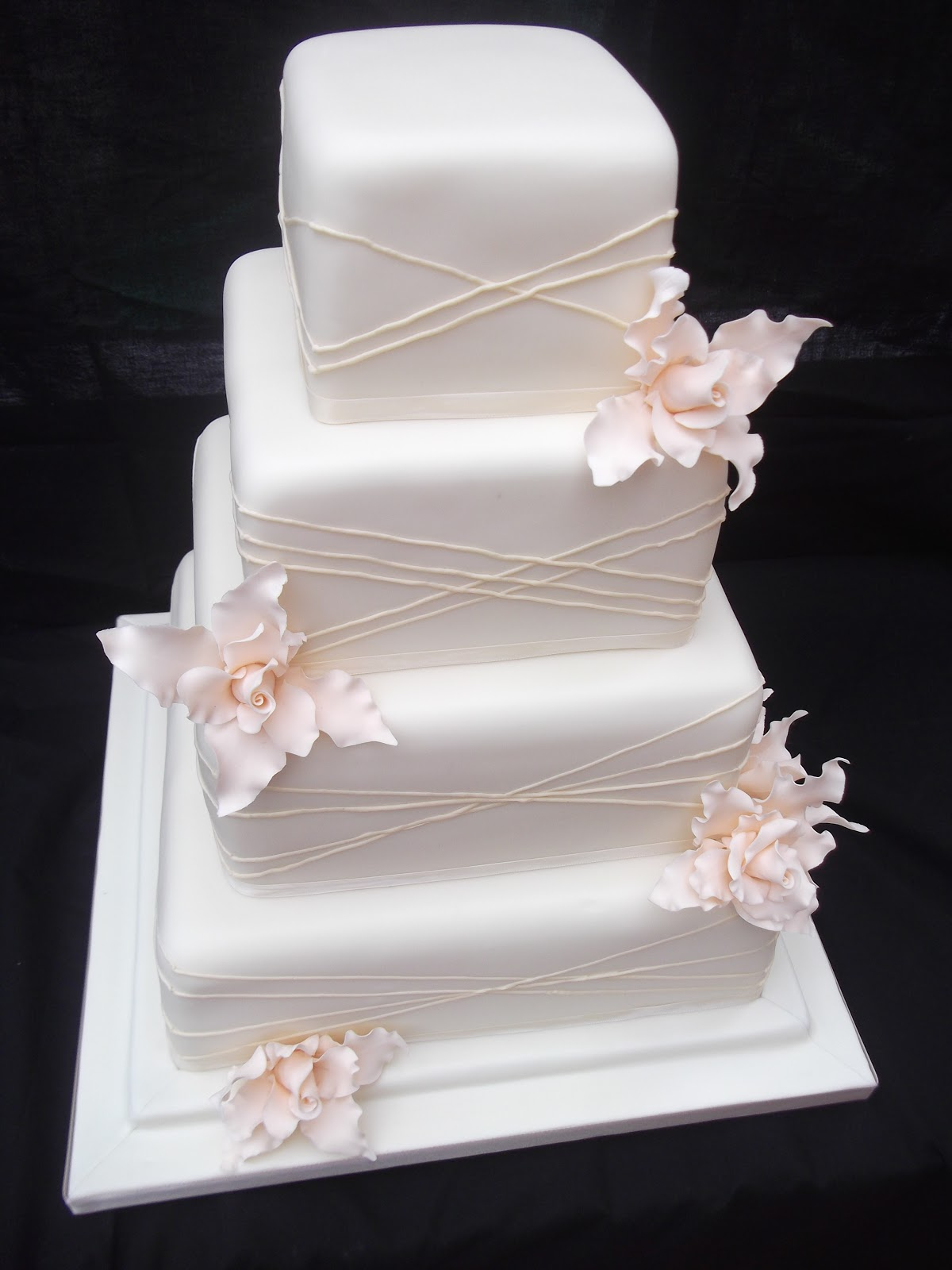 Cakes By Karen Ivory wedding cake with champagne flowers