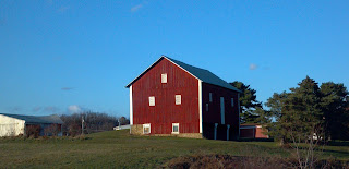 red barn on a hill