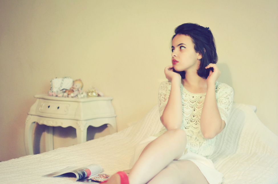 theserialshopper posing in a boudoir decor