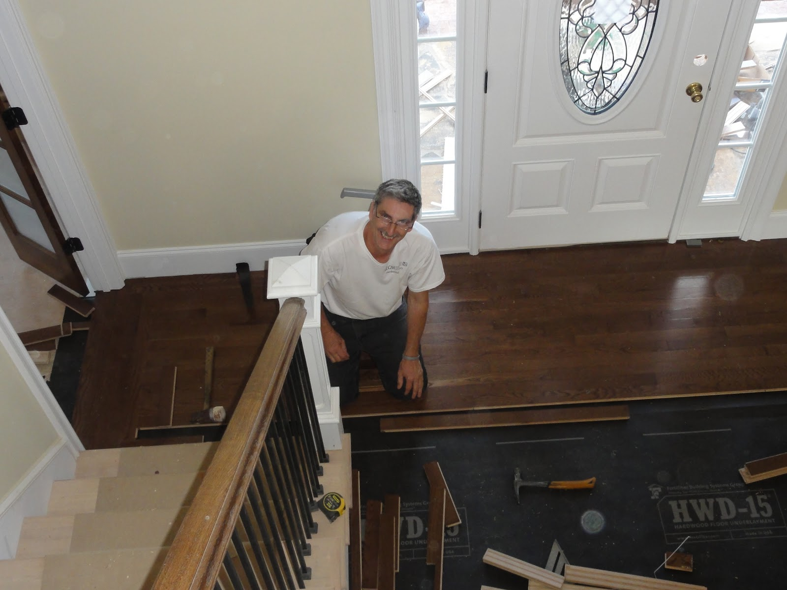 Joey Gilmore installs border and medallion in front foyer with