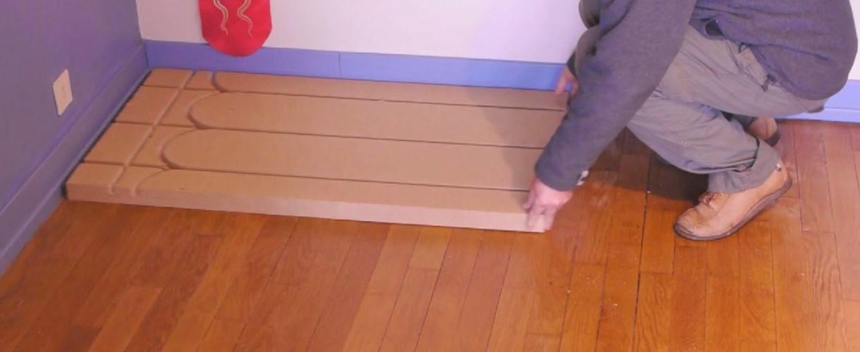 1ere etape de pose du plancher chauffant sec et mince Caleosol Eco+