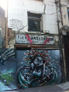 Ghost sign on abandoned building, Gun Street, London E1