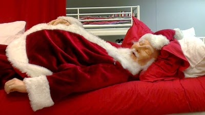 Santa crashes after a long night of delivering toys.