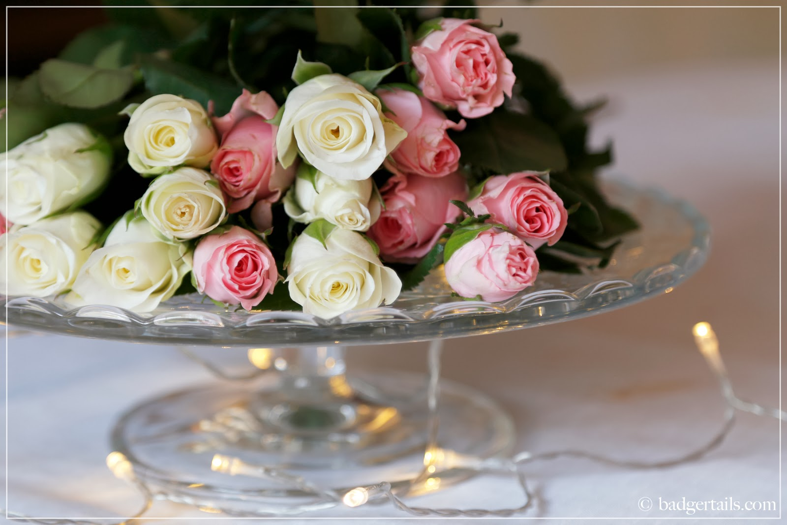 romantic pastel valentines tablescape pink and white roses on cake stand