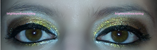 New Year's Eve mixed metals graphic eyeliner eye look, both eyes open