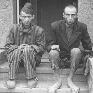 Two thin men sitting after being released from a German concentration camp
