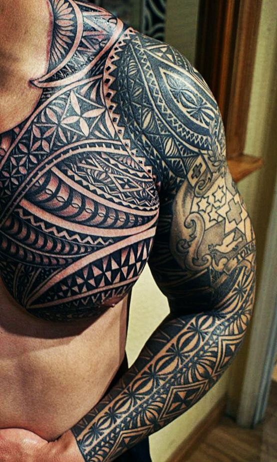 Black Tribal tattoo on arms and chest - Tattoo Mania