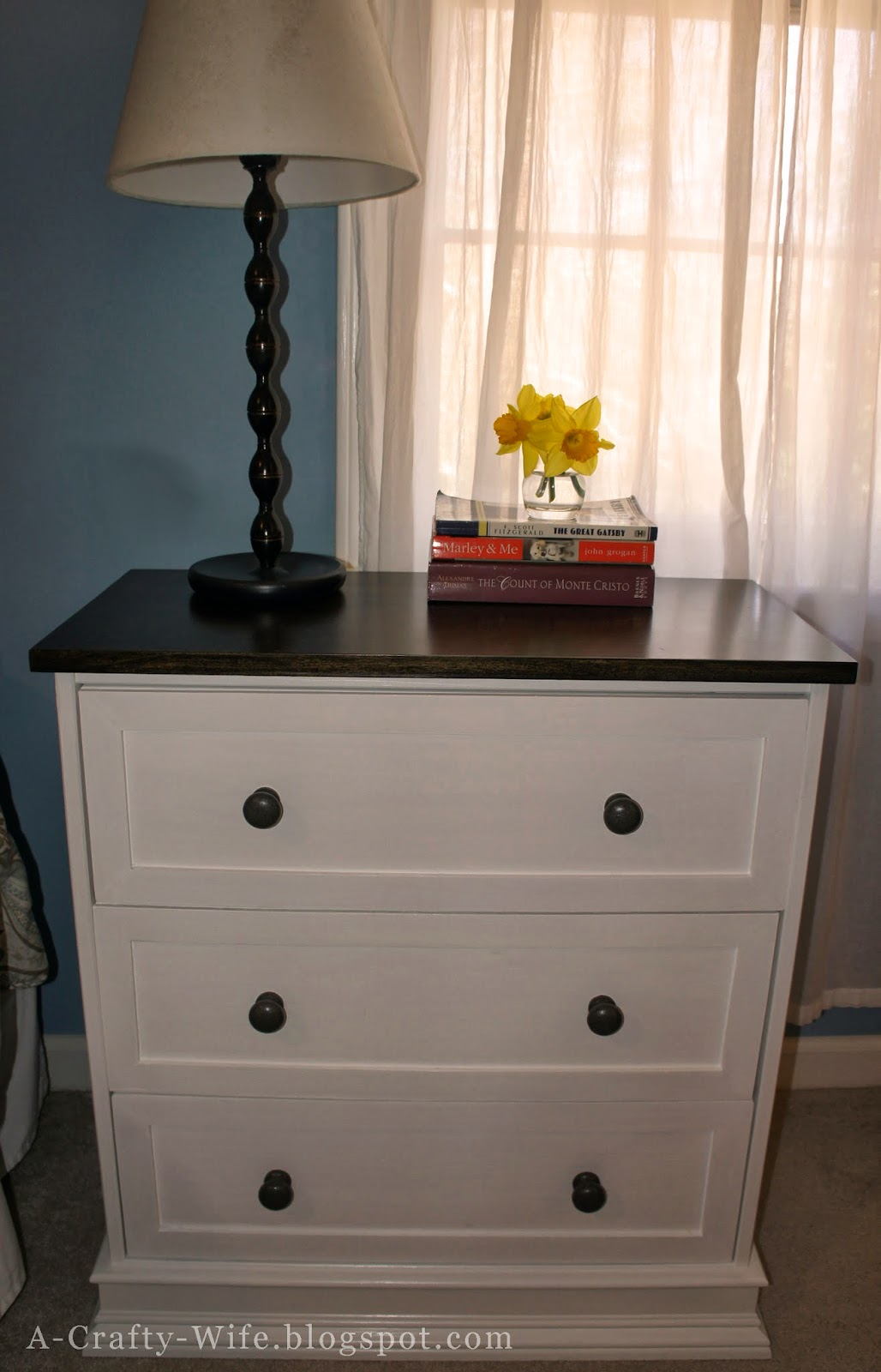 Finished Ikea Rast hack used as bedside tables | A Crafty Wife