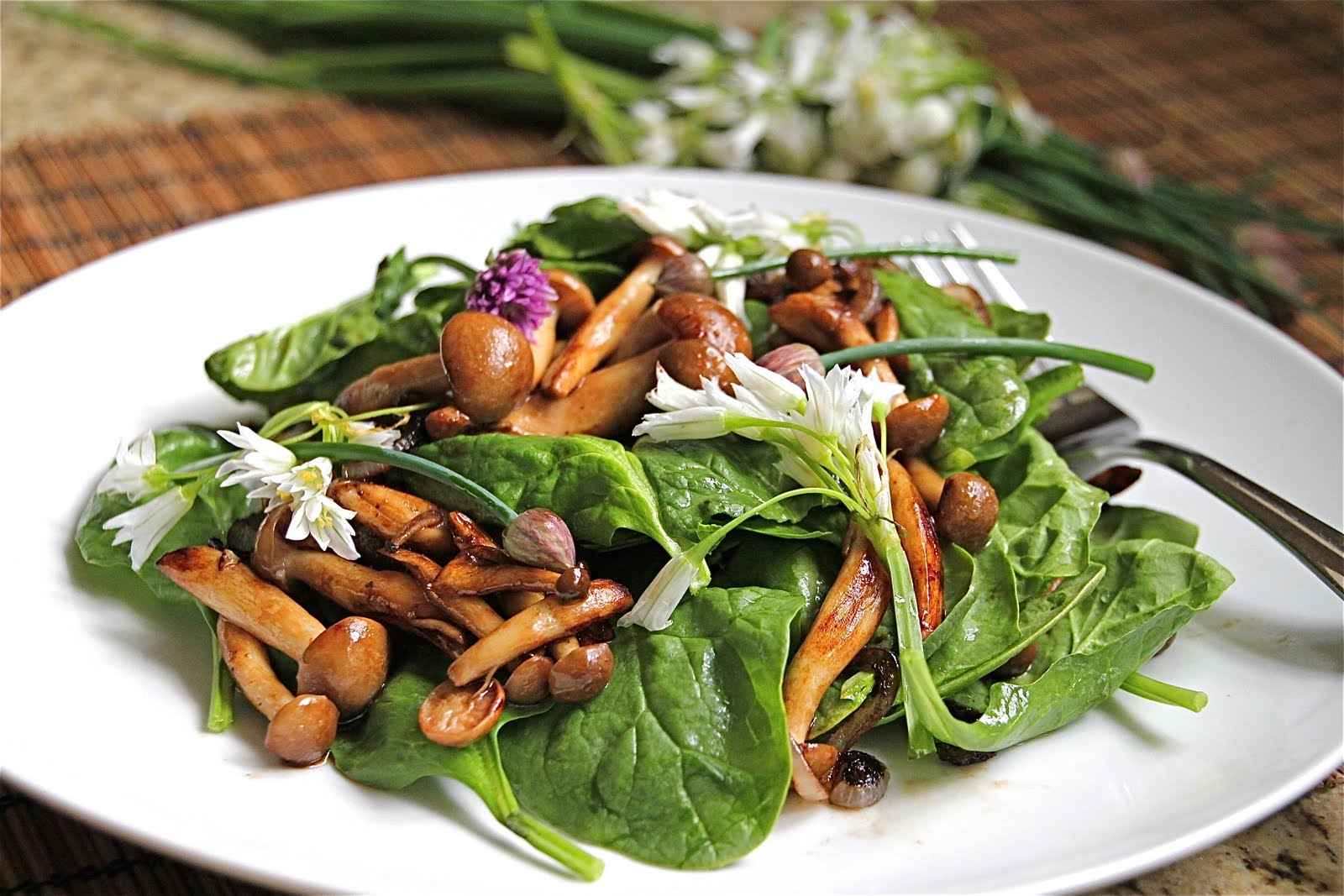Warm Mushroom Spinach Salad made extra special with Arugula and Chive Flowers