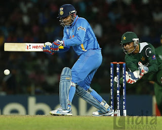 Mahendra Singh Dhoni playing shot in match against Pakistan