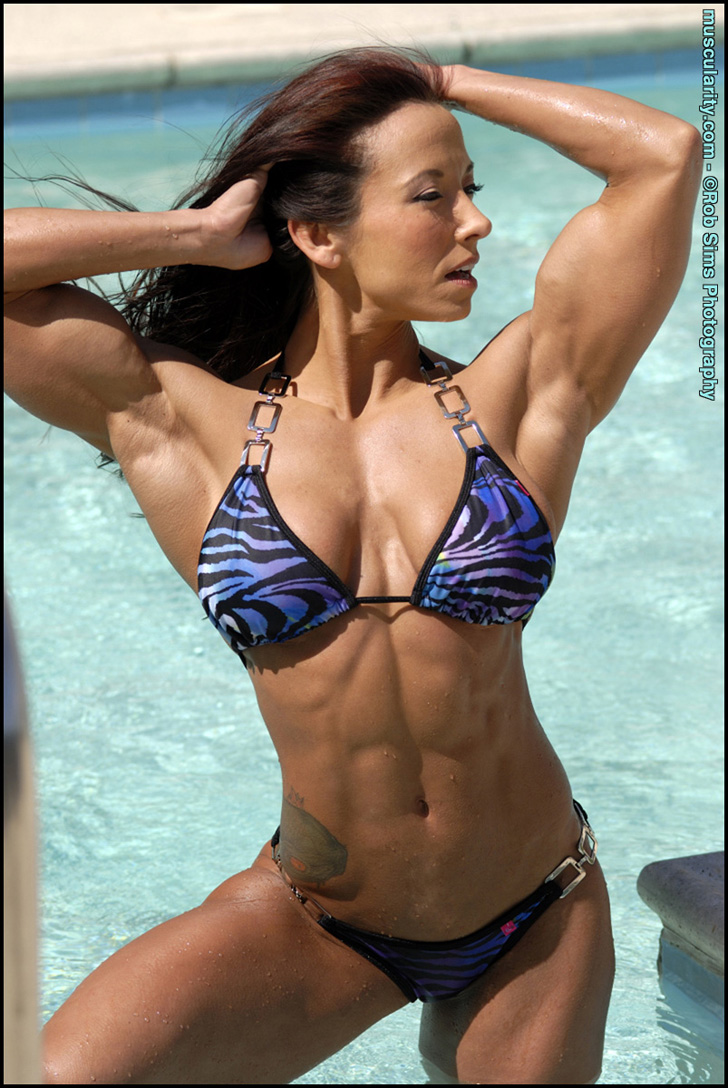 Patricia Beckman Posing Her Ripped Abs In A Blue Bikini