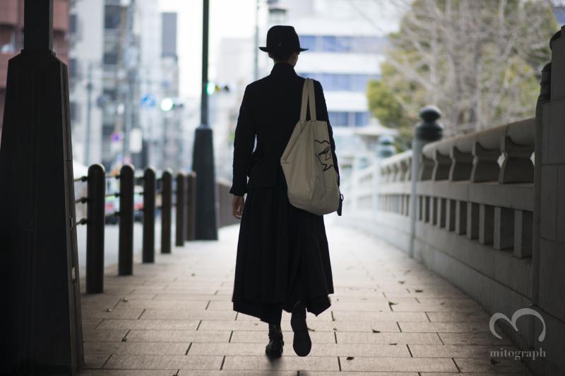 Yun Shen wears CA4LA hat Comme des Garcons jacket amd Skirt Carol Christian Poel Boots Paul Harnden Bag at Osaka Japan