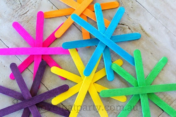 Simple pospsicle stick stars for the Christmas tree using neon coloured wooden popsicle sticks. www.lovethatparty.com.au