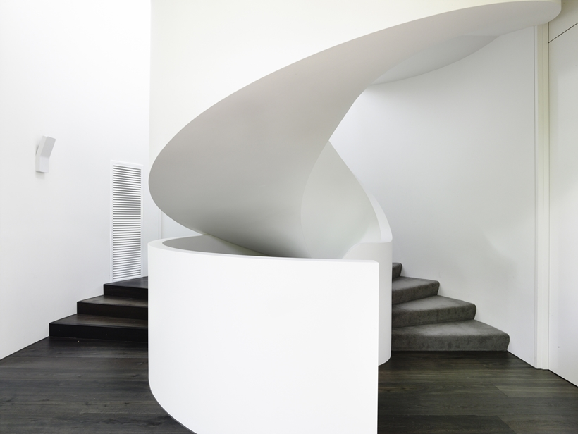 Spiral staircase in Perfect Modern Townhouse by Martin Friedrich Architects