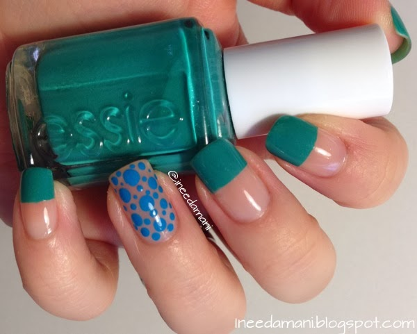 half nude green nails with blue polka dots essie naughty nautical