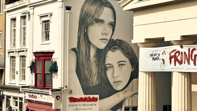 While we last heard from him in France a few days ago, RONE is back in the United Kingdom and for once it's not London! The Aussie artist invaded the city of Brighton in Southern UK where he spent a few days working on this large-scale mural.
