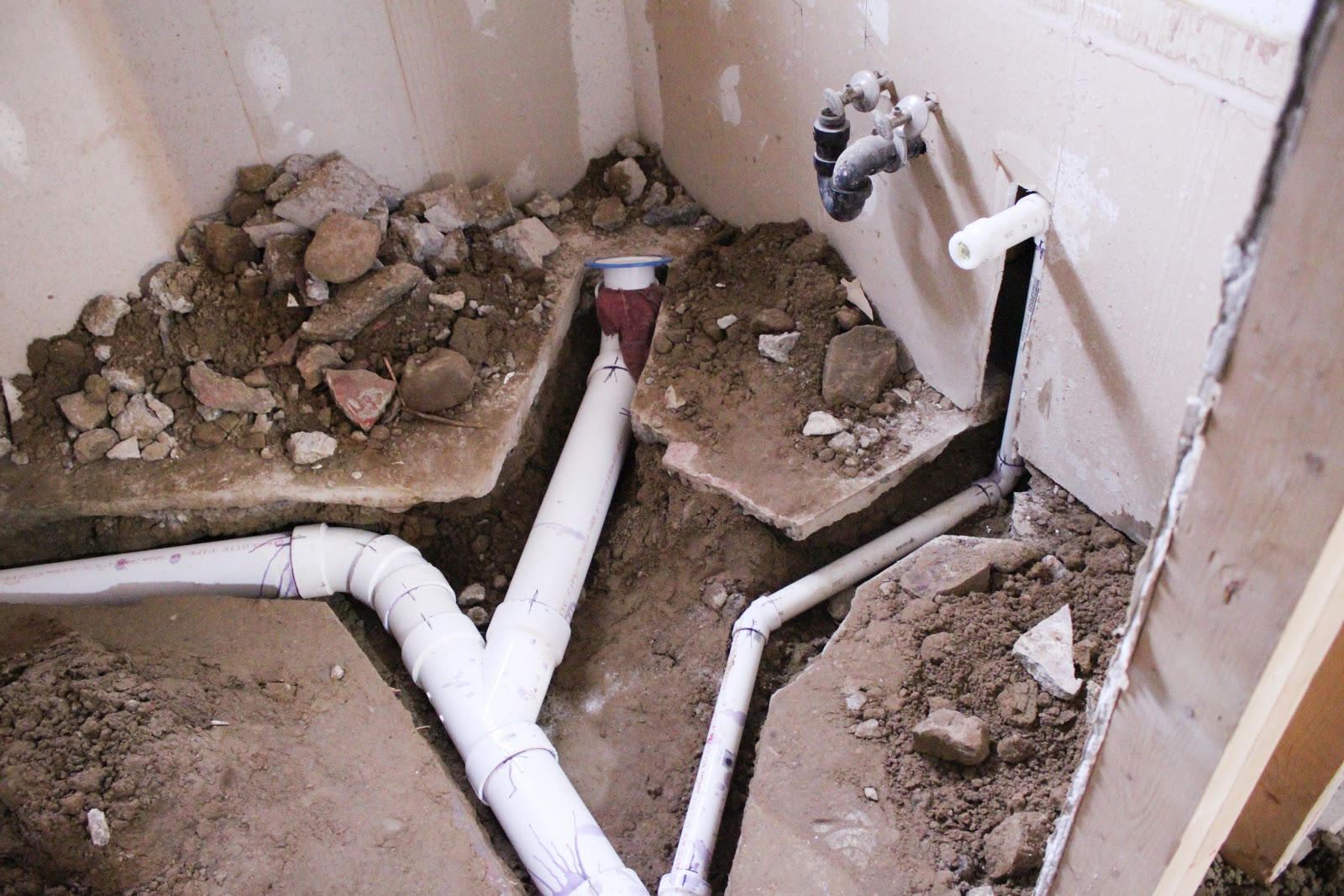 Digging holes and playing in the dirt in the basement danks and honey Bathroom toilet installation