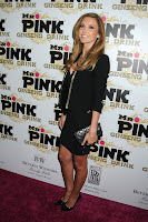 Audrina Patridge looking hot in a short black skirt on the red carpet