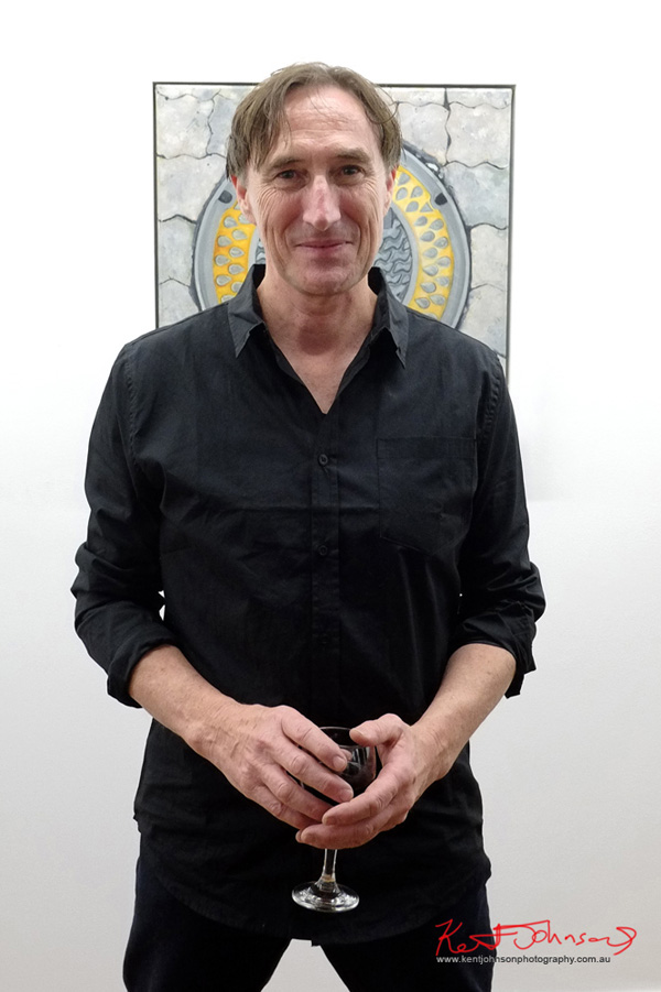 Artist portrait of Dennis McCart at the opeing night of his show 'Beneath Our Feet' at The Hold Artspace in West End, Brisbane. Photo by Kent Johnson.