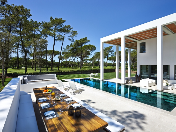 Outdoor dining table in Simple modern home in Portugal