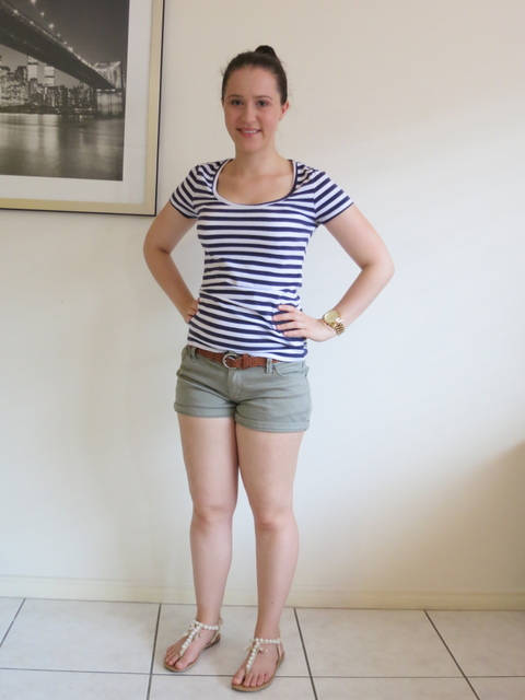 A striped t-shirt, khaki coloured shorts and cream sandals.