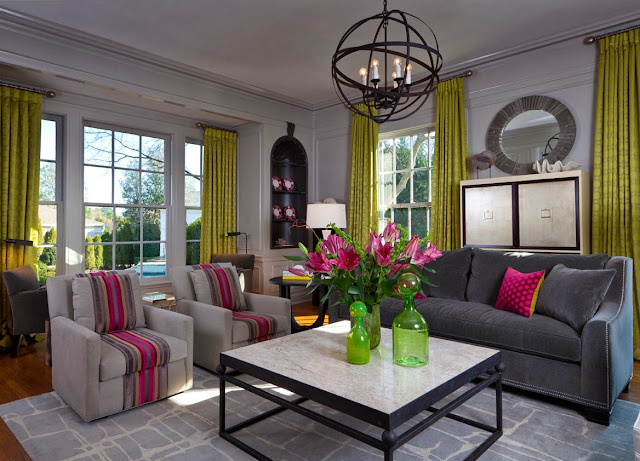 a cozy living room area in generally soft gray hue and muted color palette with pops of pink and green colors by Beckwith interiors