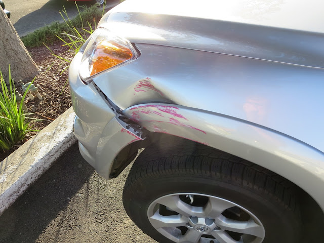 Dented fender and scraped bumper on 2012 Rav4 before auto body repairs at Almost Everything Auto Body