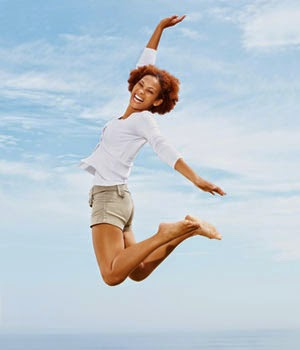 Healthy woman jumping ion the air for joy full of energy