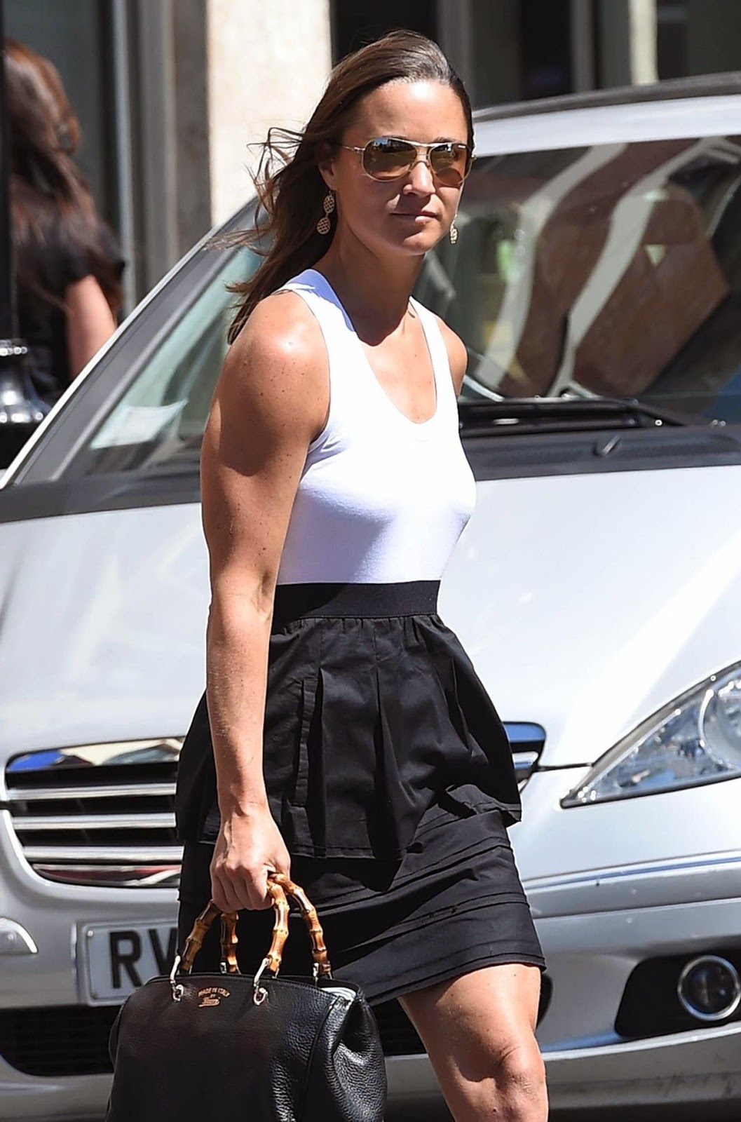 Pippa Middleton steps out in ruffled skirt and sleeveless top in Chelsea
