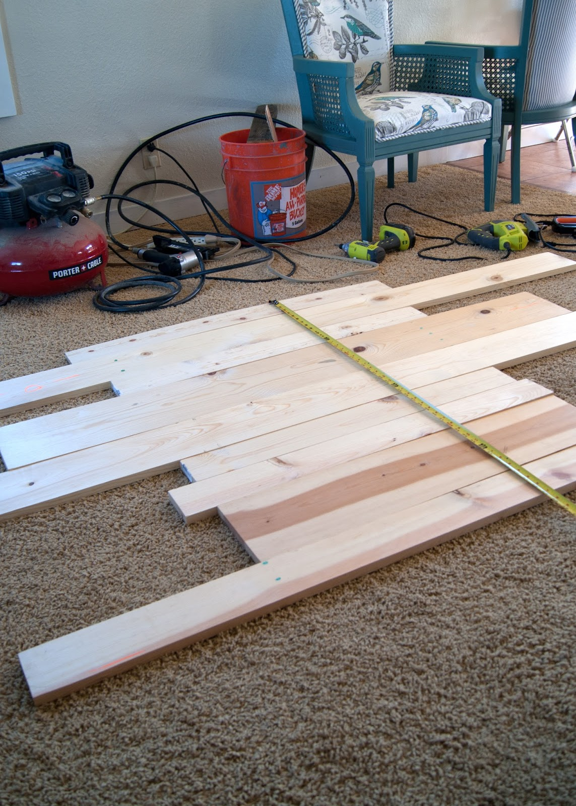 Laying out the plank pattern - Fireplace Makeover -How to Plank your fireplace