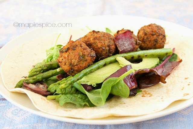 Lemon-Dill Petite Pois Falafel, Chargrilled Asparagus and Red Onion Salad Wrap. Vegan recipe.