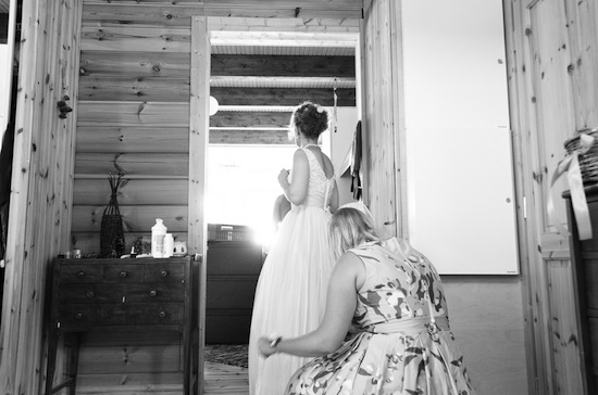 bride getting ready, bride getting her dress straightened