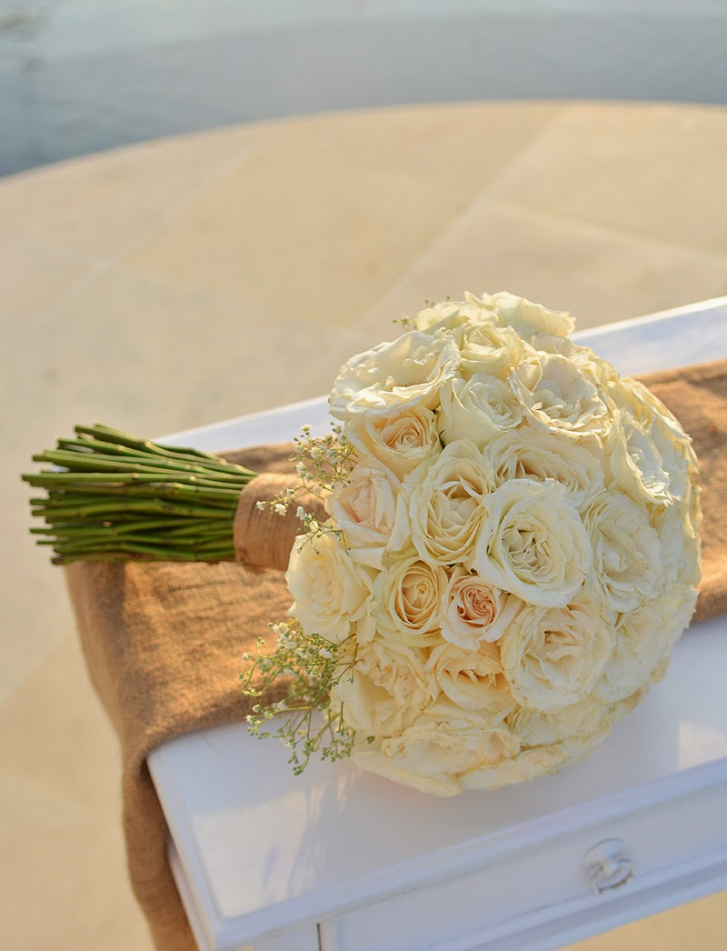 off white avalanche roses with baby's breaths bouquet