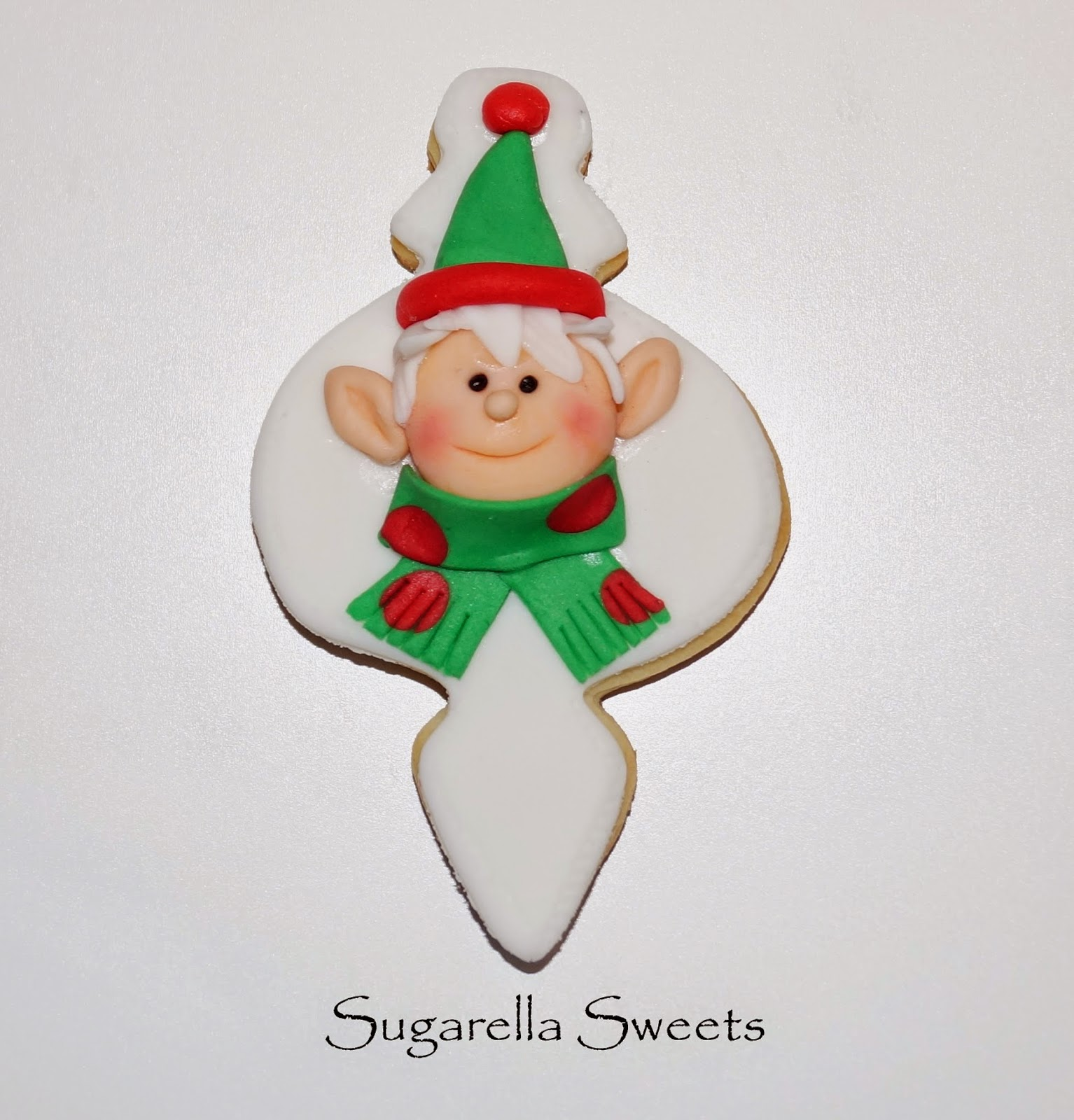 http://sugarellasweetshowto.blogspot.ca/2014/12/how-to-make-elf-cookie.html