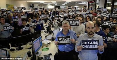 http://www.dailymail.co.uk/news/article-2900720/JeSuisCharlie-sweeps-Twitter-Internet-users-rush-solidarity-French-satirical-news-magazine-massacre.html