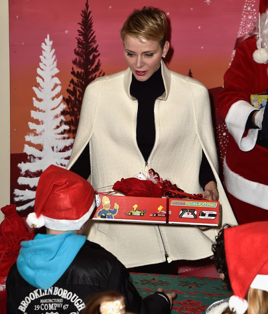 Prince Albert And Princess Charlene Attend The Christmas Gifts Distribution