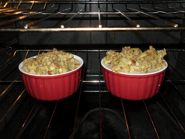 The stuffing added to the top of the filling and placed in the oven