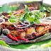 Cá đuối nướng đặc sản nước Sing với tour du lịch singapore phượt giá rẻ từ Hà Nội